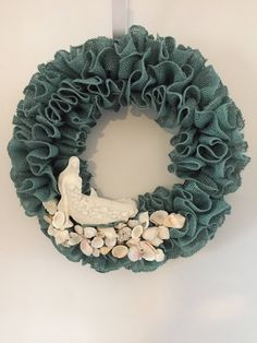 A personal favorite from my Etsy shop https://www.etsy.com/listing/535226937/mermaid-wreath-with-shells-natural