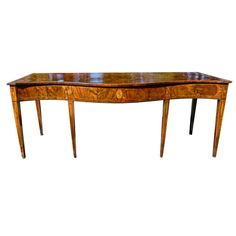 Period George III Mahogany and Yew Wood Irish Serpentine Serving Table | From a unique collection of antique and modern serving tables at https://www.1stdibs.com/furniture/tables/serving-tables/