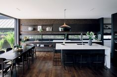 Barstools are from Matisse and the kitchen island light is a Coco pendant from Cult Design.
