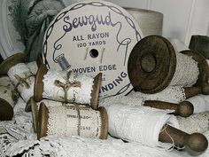 Love the wooded spools to store lace on, cute accent with the twine tied around it.