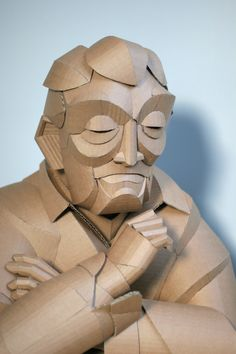 Warren King began sculpting with cardboard as an attempt to add fantasy to the lives of his children, creatively crafting masks and helmets out of the recyclable material. This slowly evolved into a more time-consuming arts practice as King began focusing less time on costumes, and more time making