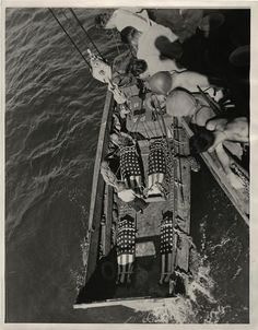 1944- Bodies on U.S. Marines go over the side of a transport where they died from wounds received in attack on Parry Island, Eniwetok Atoll, for burial on beach.