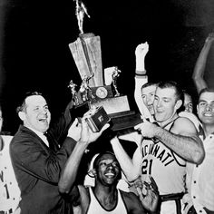 #tbt: Bearcats coach Ed Jucker & Bob Wiesenhahn (No. 21) hoist the 1961 national championship trophy after defeating Ohio State in Kansas City. Sophomore Tom Thacker (bottom center) helped the Bearcats bring home another championship title the following year. @gobearcats #HottestCollegeInAmerica