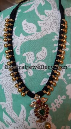 Black thread long chain with 22 carat gold clasps placed all over the set, Mango pendant attached in the center Jewelry Design Earrings, Necklace Designs, Beaded Jewelry, Thread Jewellery, Temple Jewellery, African Necklace, Black Thread, Simple Jewelry, Jewelry Patterns