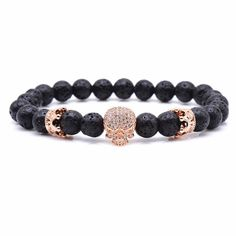 Gorgeous and elegant bracelet with two crowns and a skull in the middle. Made from semi precious natural lava stone. Size: Material: Copper, lava stone Refunds - If you don't love it, we'll refund you. Unique Bracelets, Beaded Bracelets, Skull Rock, Labradorite, Buddha Jewelry, Gold Skull, Skull Bracelet, Rose Gold, Halloween Jewelry