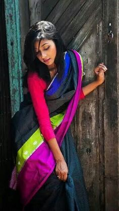 This is how Coloroso describes its Chanderi saree......ebony black with davy's gray striped body, purplr pizzazz border with sliver zari mogra on harlequin green..... phew and sigh!!
