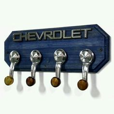 car part furniture Chevrolet Coat Rack Chevy Hat Rack with 4 Chrome by StarlingInk, can do this with my spare parts!