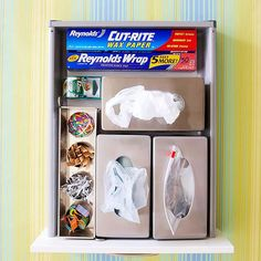Storage Tip: Use metal tissue holders to take control of your plastic and zip-top bags! More secrets: http://www.bhg.com/kitchen/remodeling/kitchen-projects/diy-kitchen-storage-ideas/