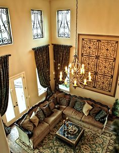 Two Story Traditional Living Room With Faux Iron Window Inserts Custom Draperies And Wall