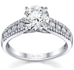 Channel set engagement ring u-pave accent diamonds.  Wow, what a stunner!