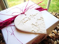 She is selling these 20 for $60... Wedding Favor Thank You Tags Gift Hang Tag Set of 20 Polymer Clay Heart Floral Vintage Shabby Chic Wedding Theme White