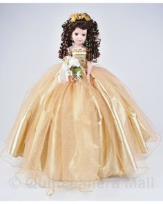 """Glittery Tulle Quince Doll #QD25 QD25 24"""" Quinceanera doll with porcelain face and arms. This is one fancy doll! Curly long hair stands out with fancy flowers on hair. Dressed in a faboulous super poofy glitter tulle dress with gold or silver trim on skirt and blouse."""