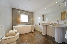 His and hers sinks are a wonderful addition in the bathroom and create an air of luxury. Taylor Wimpey, His And Hers Sinks, Relaxing Bathroom, New Homes For Sale, Corner Bathtub, Own Home, Ideal Home, Luxury, Bathroom Ideas