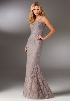Evening Gowns and Mother of the Bride Dresses by Morilee. Elegant Lace Social Occasion Dress Featuring Delicate Allover Beading and Illusion Neckline.