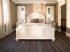 Few things says coastal-inspiration better than a white, wooden bed with louvered panels.