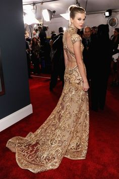 Golden lace, with a bare back, nailed it Taylor