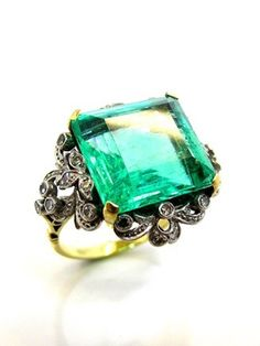 Oh My God! Yeeeeees!!!! Colombian Emerald Ring - Circa:1910 The stone is way too big but I love the shape and band