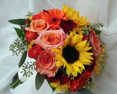 Sunflowers, roses, gerbera daisies. Derocher Florists. Needs a little purple/amethyst in it.