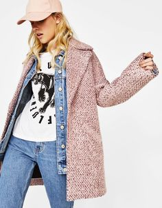Bouclé coat. Discover this and many more items in Bershka with new products every week