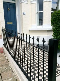 A traditional style for a period property in this London Front Garden. We matched a Victorian style black & white tiled pathway with cast iron style railings for a beautiful outcome. Victorian Front Garden, Victorian Terrace, Front Path, Front Yard Fence, Victorian Mosaic Tile, Black Railing, Garden Railings, Cast Iron Fence, Small Front Gardens