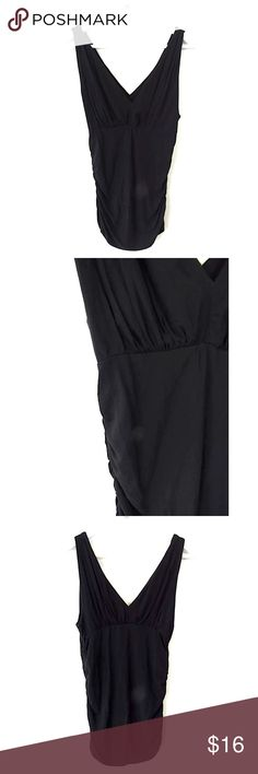 """CAbi Black Grecian Sleeveless Top Sz M #542 Brand:  CAbi Style: Sleeveless tank, ruched sides, deep V front & back, empire waist Size:  M Color/Pattern: solid black   Material:  94% rayon, 6% spandex Measurements taken flat:   -Shoulder to hem: 28"""" -Across under arm: 16"""" Garment Care:  machine wash,  flat dry Condition: No flaws. CAbi Tops Blouses"""