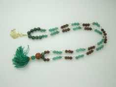 Amazon.com: Om Prayer Mala Beads Crystal Rudraksha Green Jade Heart Chakra: Tarini Jewels: Jewelry