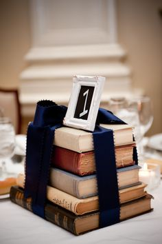 cute book centerpiece - purple  sheer ribbon?