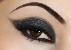 Love the black eyeshadow with silver glitter...