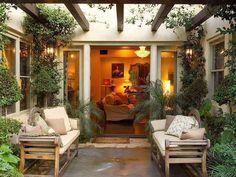 Mediterranean Patio with exterior stone floors, Trellis, Lutyens bench, French doors