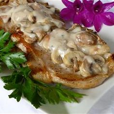Mushroom Pork Chops   Ingredients    4 pork chops  salt and pepper to taste  1 pinch garlic salt, or to taste  1 onion, chopped  1/2 pound fresh mushrooms, sliced  1 (10.75 ounce) can condensed cream of mushroom soup  Thyme  Minced garlic