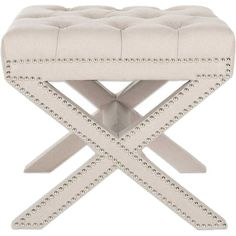 An eye-catching addition to your master suite or powder room, this elegant ottoman is dressed in lovely button tufts and nailhead accents.