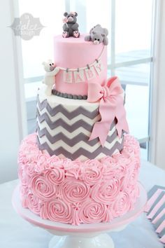 White, pink, and gray baby shower cake with chevron, flat rose, and pick bow with fondant bears