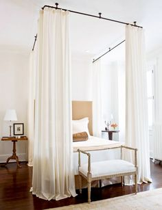 Elegant White Bedroom With Industrial Piping Curtain Rods