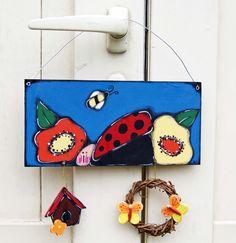 Plaque de porte avec coccinelle dans le jardin de la boutique LULdesign sur Etsy