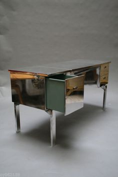 Polished Aluminum Campaign Desk  USA  1940's  An amazing polished aluminum campaign desk with drawers. Used by the U.S. military during World War II, this desk folds up into the size of a large suitcase.