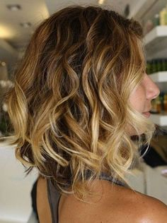 Curly Bob Hairstyle.  @Stephanie Close Close Allen I wanna do something like this with my hair along with my caramel highlights :)  What do you think?