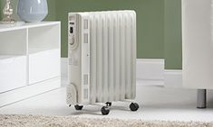 c1151ab3973 Zennox Oil Filled Radiator 2000W 9-Fin Portable Electric Heater 3 Heat  Settings with Adjustable Thermostat