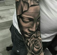 black and grey virgin Mary tattoo