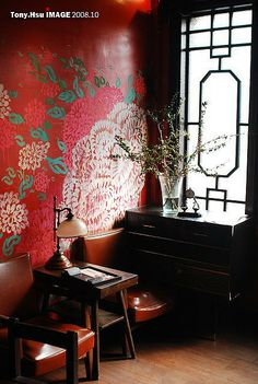 Modern Chinoiserie with bold, oversized wallpaper/graphic.