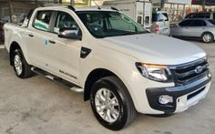 Ford Ranger Wildtrak 2014 Model Thailand White front side view  photographed at Thailand Pickup Truck Exporter Jim Autos http://toyota-dealer.org/thailand-ford-ranger-exporter.html