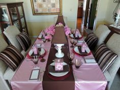 It's All About Me! – Tablescapes at Table Twenty-One: Dining table. pink brown. full length brown tablecloth, 2 pink runners along the sides. Hot pink charger, white plate, brown napkin, party favor bag (plus notepad were inspiration)