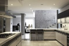 A contemporary custom made Poggenpohl kitchen for a family home in the heart of Johannesburg's old leafy suburbs.    #poggenpohl #modernkitchen #handle #custommade #familyhome