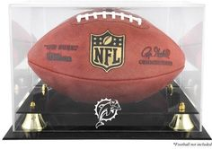 Miami Dolphins Golden Classic Football Display Case and Mirror Back  http://allstarsportsfan.com/product/miami-dolphins-golden-classic-football-display-case-and-mirror-back/    The Miami Dolphins Golden Classic football logo display case comes with a black acrylic base, gold risers and a mirrored back. The case is made of 1/8 thick acrylic and features a clear acrylic removable lid with engraved team logo. Perfect for a collectible football. Officially licensed by...