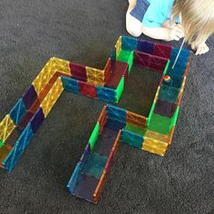 Magna-Tects made a little #magnatiles track to blow a pom-pom through with a straw. This has given us lots of other ideas!