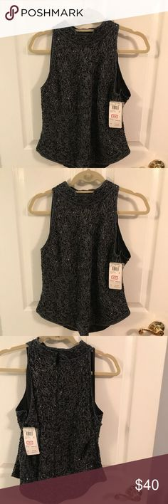Black beaded top Never worn. This top is beautiful. Never worn.  Size XL.  Great for a formal affair or wedding. Will go great with Palazzo pants for sale in my closet Adrianna Papell Dresses Wedding