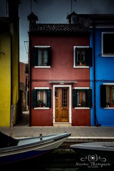Colourful sights of Burano, Venice. Italy. Travel photography with rainbows.