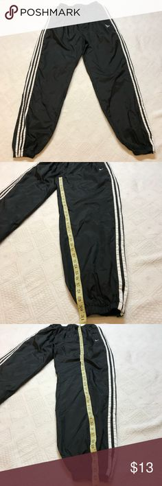 Adidas Large Triple Stripe Windbreaker Joggers Triple stripe Windbreaker joggers in a size Large. I noticed a scratch on one side of one knee and am selling as is. I pictured it. The drawstring is still there and there are no other flaws adidas Pants Sweatpants & Joggers