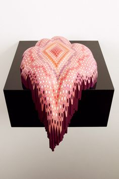 Australian artist Lionel Bawden uses hexagonal colored pencils as a sculptural material, arranging and glueing hundreds of pencils together then carving the mass into nondescript shapes