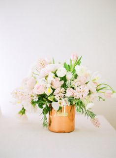 Blush-colored flowers and a copper pot make a delicate but stunning statement centerpiece~!