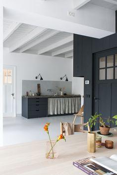 Christen-Starkenburg Interieur-Plus workspace/curtained kitchen at Jan de Jong, a design shop in Friesland, the Netherlands   Remodelista